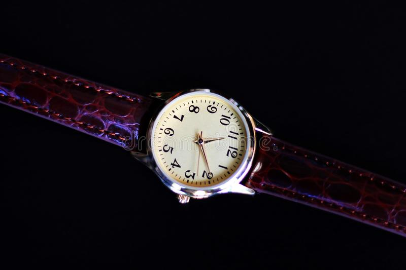 Isolated gold and quartz watch with leather strap. stock images