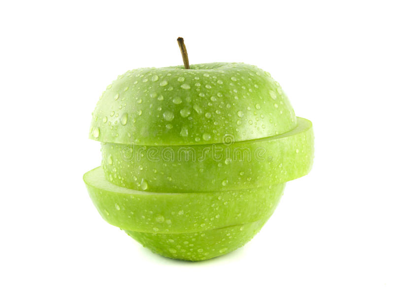 Isolated green apple slices with water drops. (white background). Fresh diet fruit. Healthy fruit with vitamins stock photo