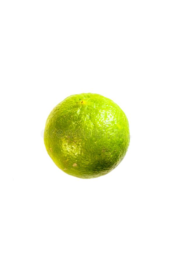 Isolated Green lemon or lime with white die cut. Background with green and yellow texture skin royalty free stock images