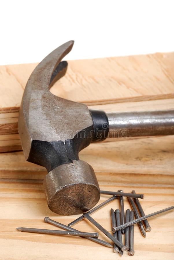 Isolated hammer and nails royalty free stock photography