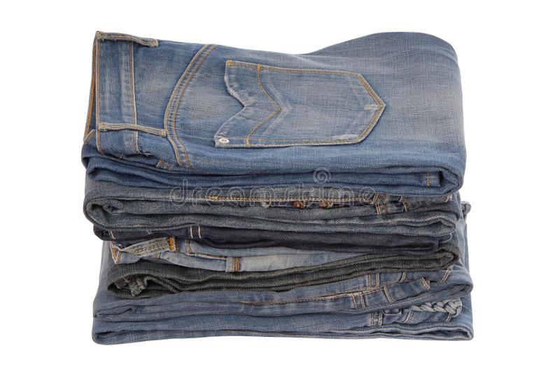Isolated heap of blue jeans, a pile of jeans-wear is on white royalty free stock image