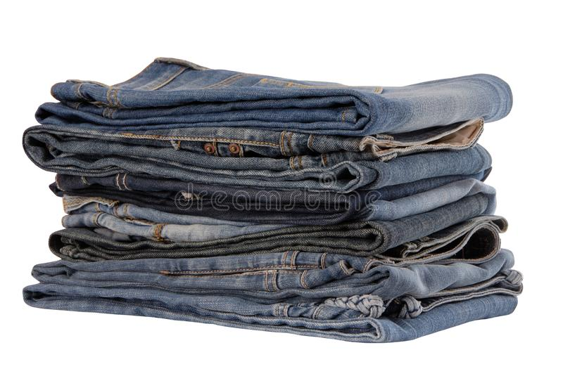 Isolated heap of blue jeans, pile of jeans-wear is on white royalty free stock photos