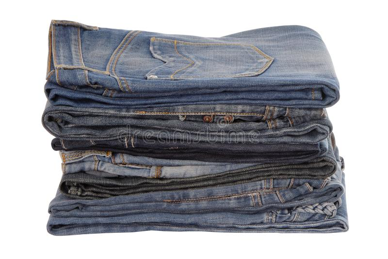 Isolated heap of blue jeans, a pile of jeans-wear is on white royalty free stock photography