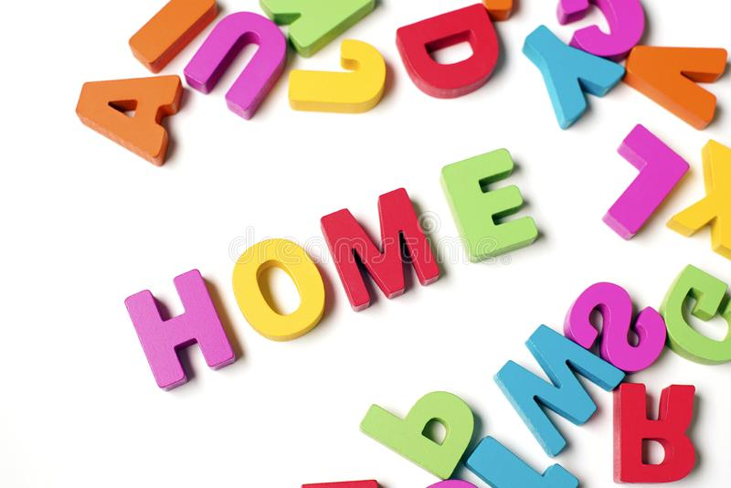 Isolated ` HOME ` Colorful Wooden Letters and Word, Learning English Word stock images