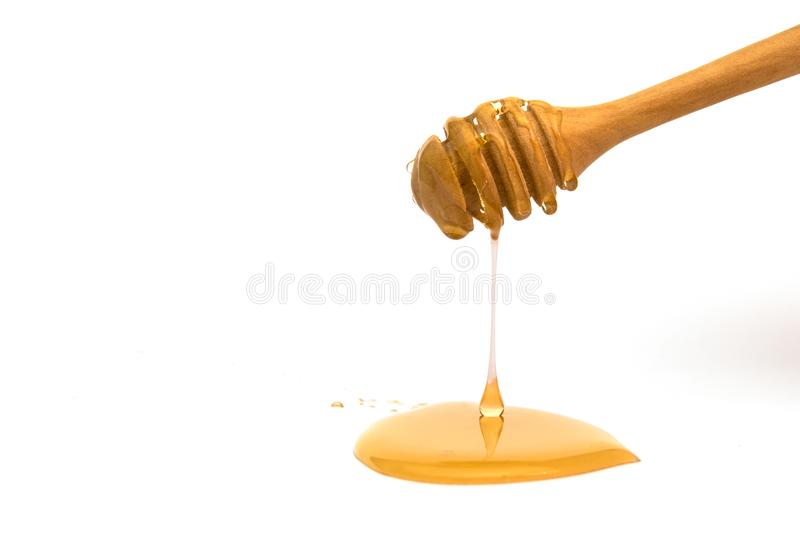 Isolated honey dripper. On white background royalty free stock photo