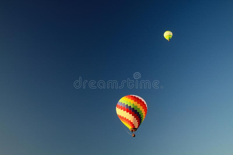 Isolated hot air balloons against blue sky over karst hills along Nam Song Xong river, Vang Vieng, Laos royalty free stock photo