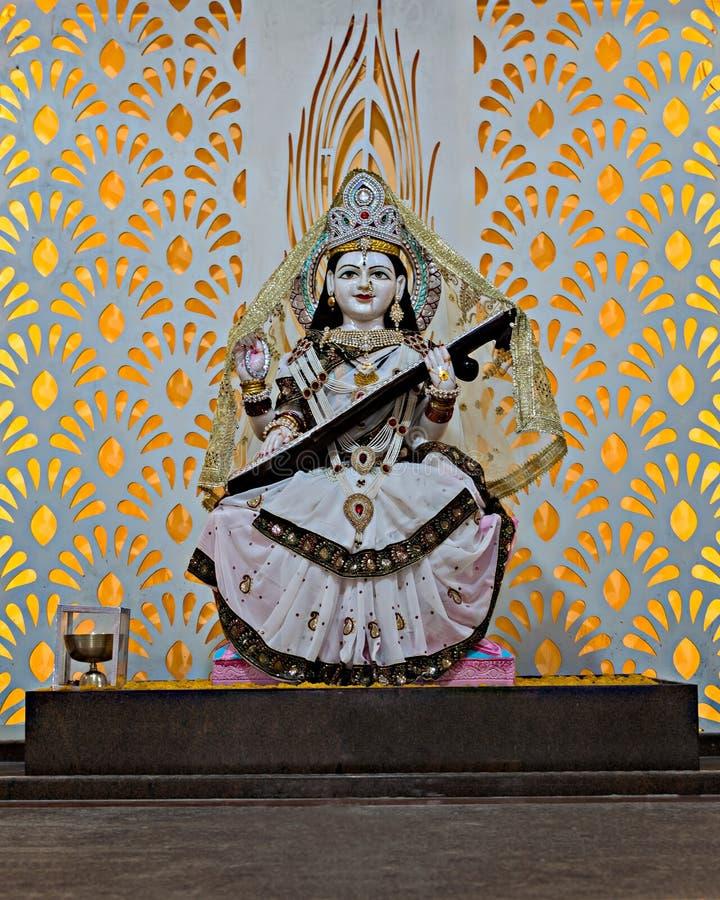 Isolated idol of Hindu Goddess Saraswati in a temple at Yavatmal, Maharashtra, India. Nicely decorated Idol of Hindu Goddess Saraswati in a temple at Yavatmal stock images