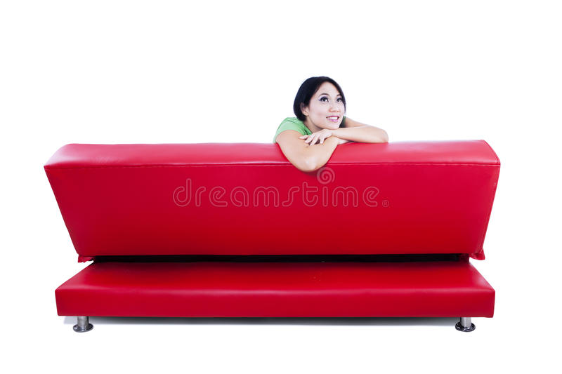 Download An Isolated Image Of Red Sofa With Pensive Female Stock Photo - Image: 32327186
