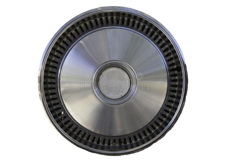 Vintage Chevy hubcap. Isolated image of vintage Chevrolet automobile hubcap stock photo
