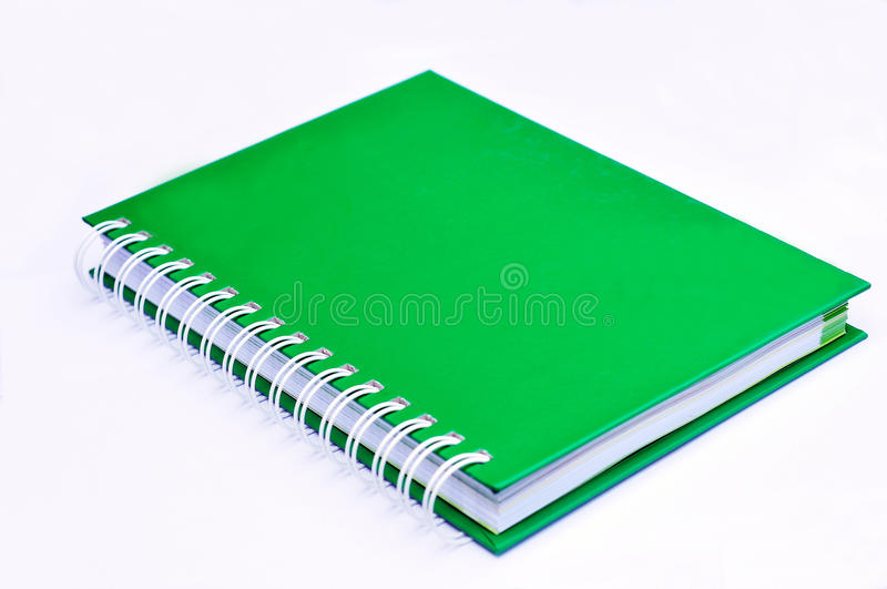 Isolated incline green note book. On white royalty free stock image