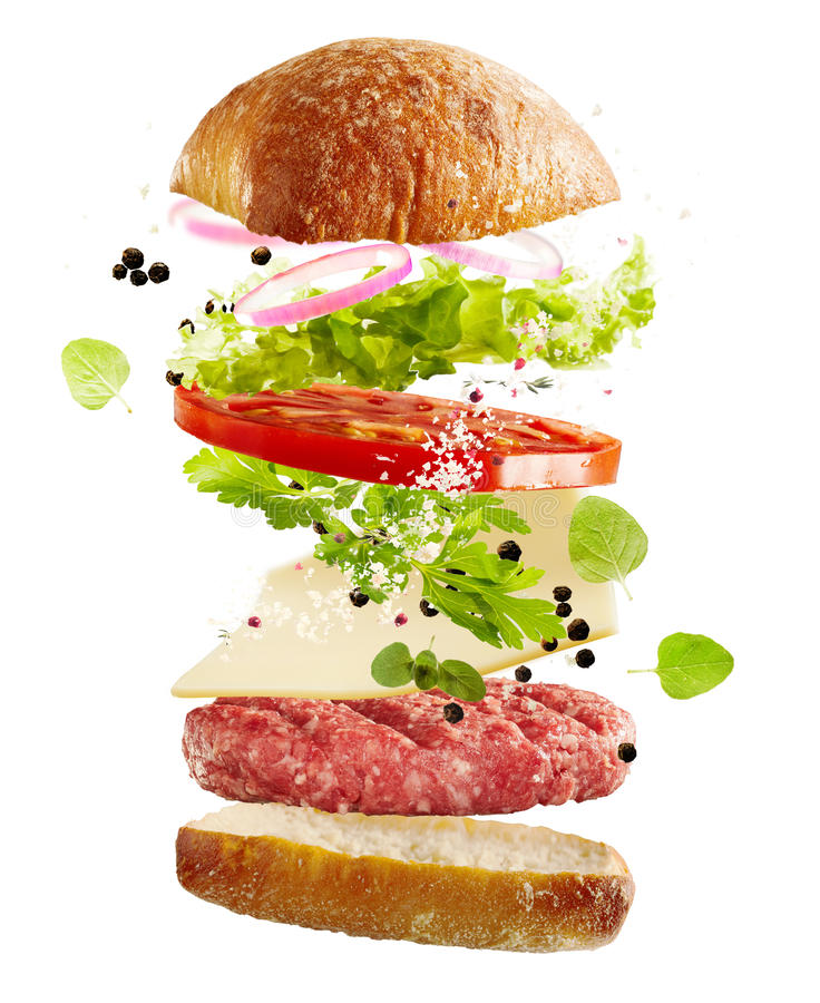 Ingredients for a hamburger floating in air stock image