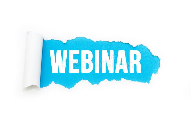 Isolated inscription `webinar` on a blue background, ripping paper. vector illustration