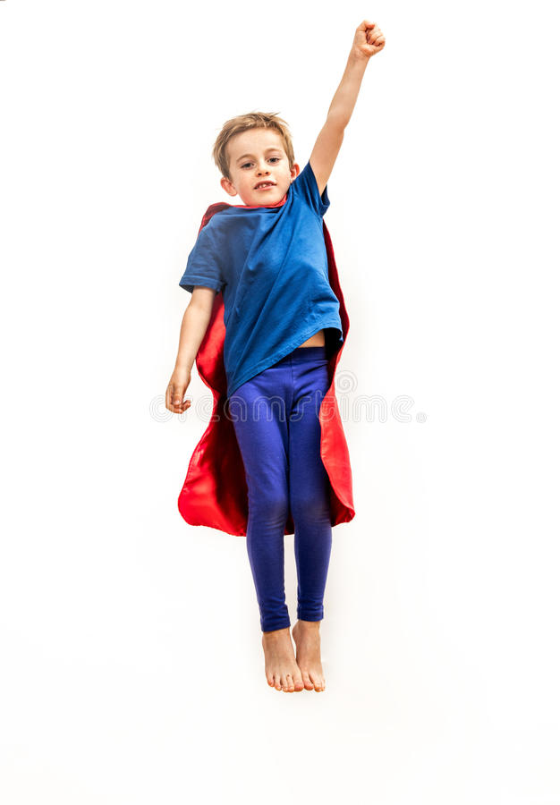 Isolated kid reaching high like powerful superhero, pretending reaching something. Dynamic isolated kid reaching high like a powerful superhero, flying with an royalty free stock image