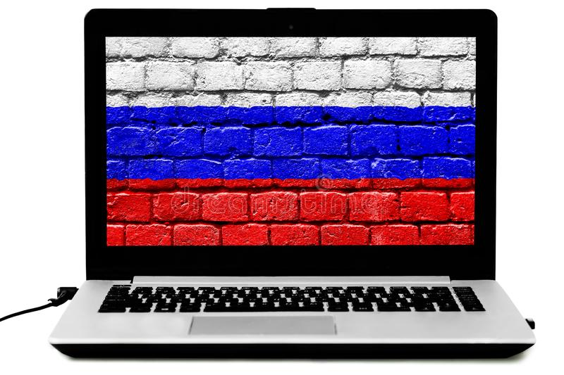 Isolated laptop with the Russian flag painted on a brick wall on the screen stock photo