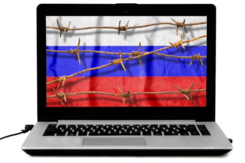 Isolated laptop with rusty barbed wire and the Russian flag on the screen royalty free stock photos