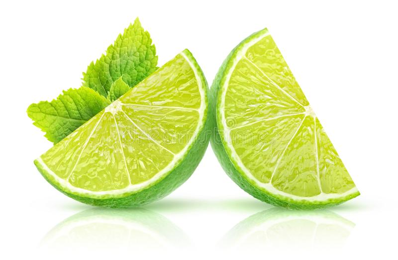Isolated lime and mint. Isolated lime slices. Two pieces of lime fruit with mint leaf isolated on white background with clipping path stock photos