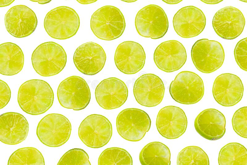 Isolated lime pattern or wallpaper on white background. Summer c. Oncept of fresh ripe lime liths and slices shot from above royalty free stock photography