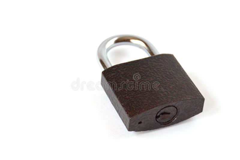 Isolated locked textural brown padlock on a white background royalty free stock photos