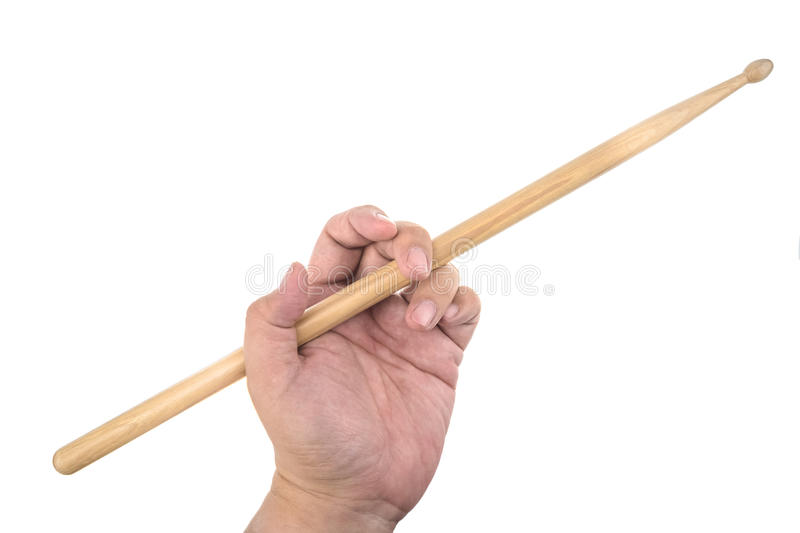 Isolated male left hand holding drum stick in traditional position. On white background royalty free stock photo