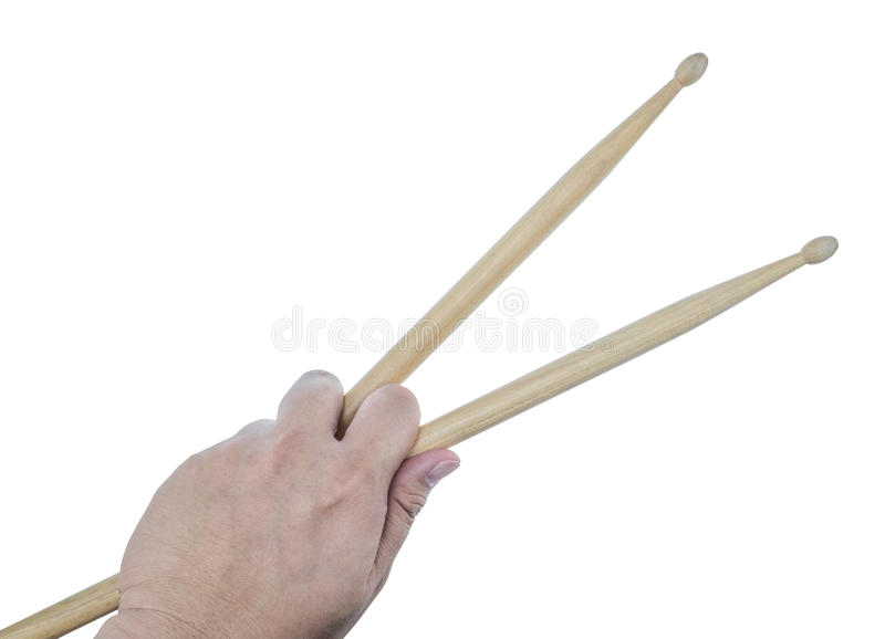Isolated male left hand holding drum sticks. On white background royalty free stock photography