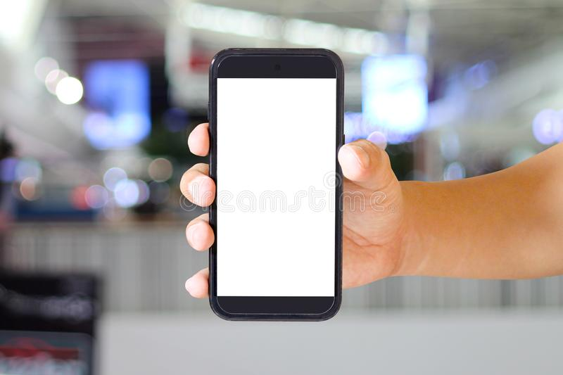 Isolated Man hand holding modern smartphone on Blurred background, mock-up smartphone. Stock photo, images and stock photography. Image royalty free stock photo