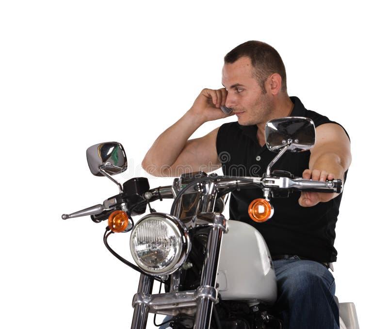 Isolated man on motorbike stock photo
