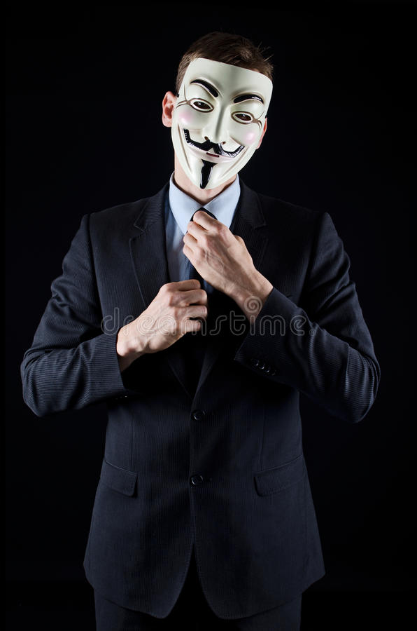 Isolated man wearing Vendetta mask