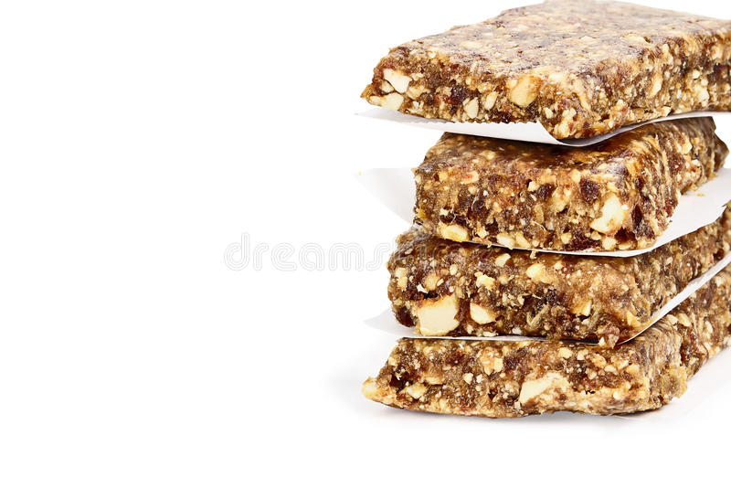 Isolated Medjool Date and Cashew Protein Bars. Isolated on white with light shadow and clipping path royalty free stock images