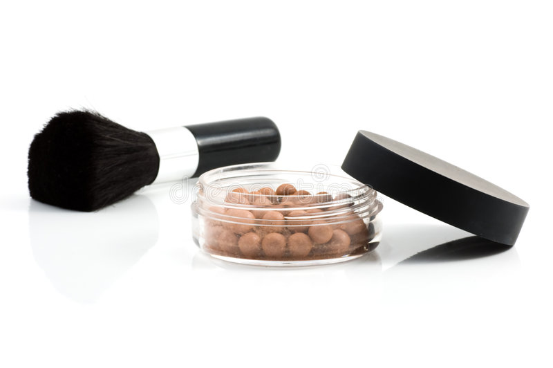 Isolated mineral make-up with brush royalty free stock photography