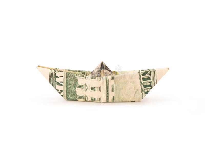 Isolated money origami ship stock photography