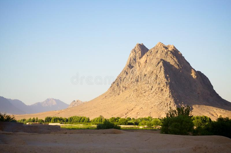 An isolated mountain in Kandahar, Afghanistan. An isolated mountain peak abruptly juts up from the landscape of Kandahar Province, Afghanistan royalty free stock photo