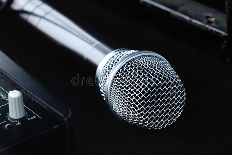 Isolated new silver microphone. On black background stock photography