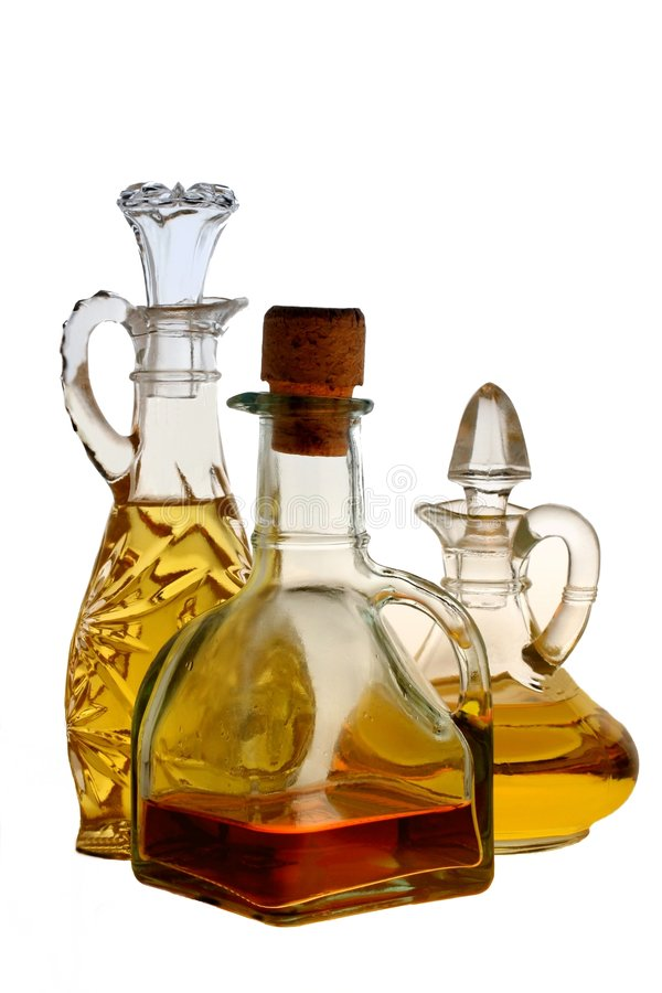 Isolated Oil and Vinegar Bottles royalty free stock images