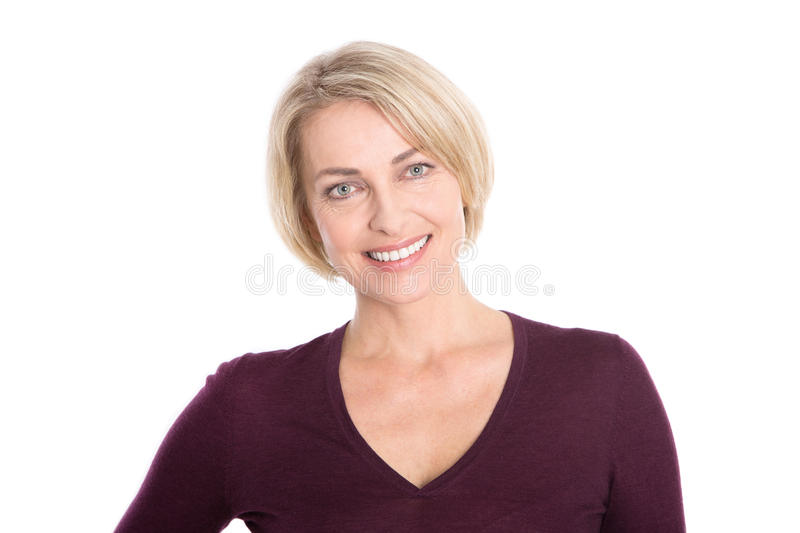Isolated older woman with blond hair - relaxt and smiling. royalty free stock photography