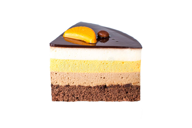Isolated orange chocolate cake with layers of delicate souffle, a Delicious homemade dessert. stock photos