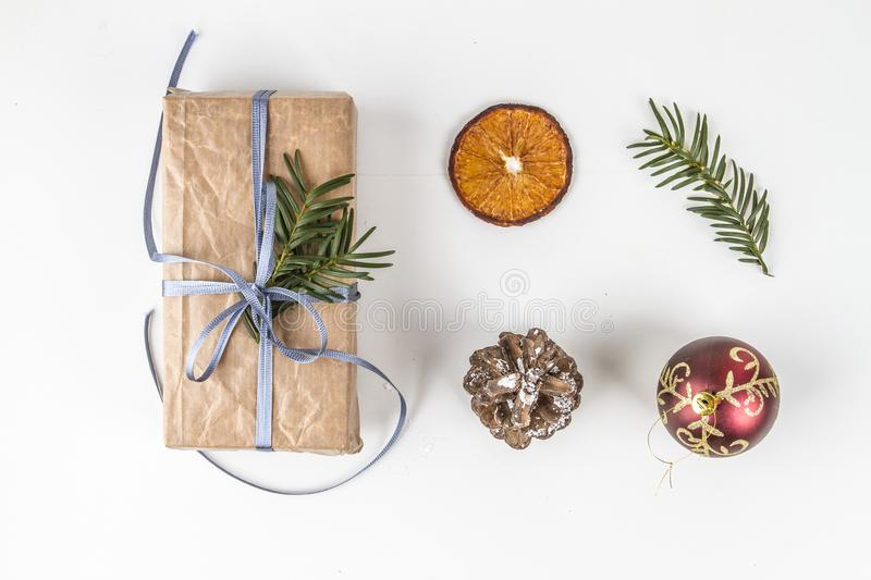 ISOLATED OVERHEAD RUSTIC HOMEMADE PRESENT BOX AND CHRISTMAS ORNAMENTS ON WHITE BACKGROUND. stock image
