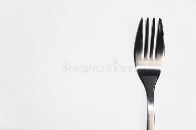 Isolated part of fork for food dining on white background royalty free stock images