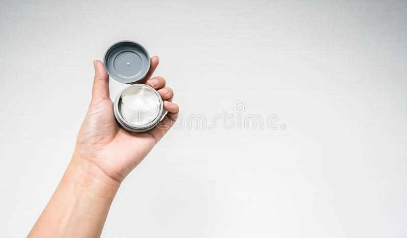 Isolated people hand hold wax for hair style royalty free stock images