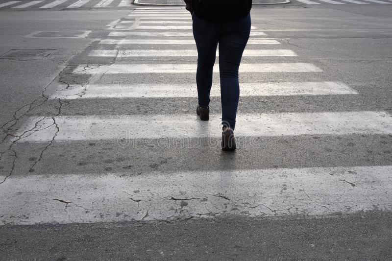 Isolated person on the crosswalk stock photos