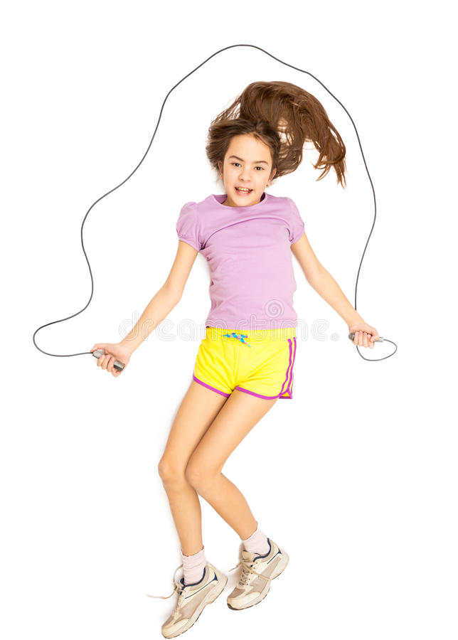 Isolated photo of smiling girl jumping with skipping rope royalty free stock photography