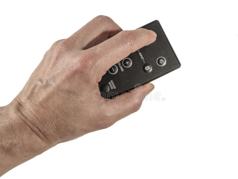 Hand holding a remotecontrol royalty free stock photo