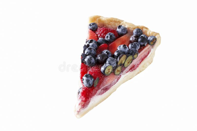 Isolated Piece of ricotta tart cake with fresh strawberry, blueberry and raspberry. Selective focus. White background royalty free stock photography