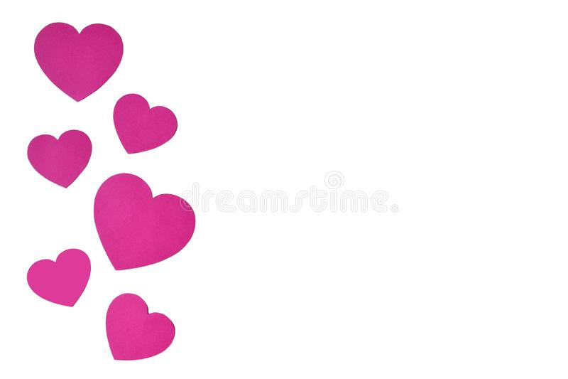 Isolated pink paper hearts in line sideways in form of a decorative frame on a white background royalty free stock photos