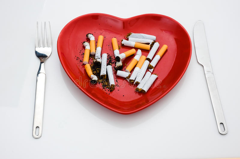 Isolated plate with cigarette stock images