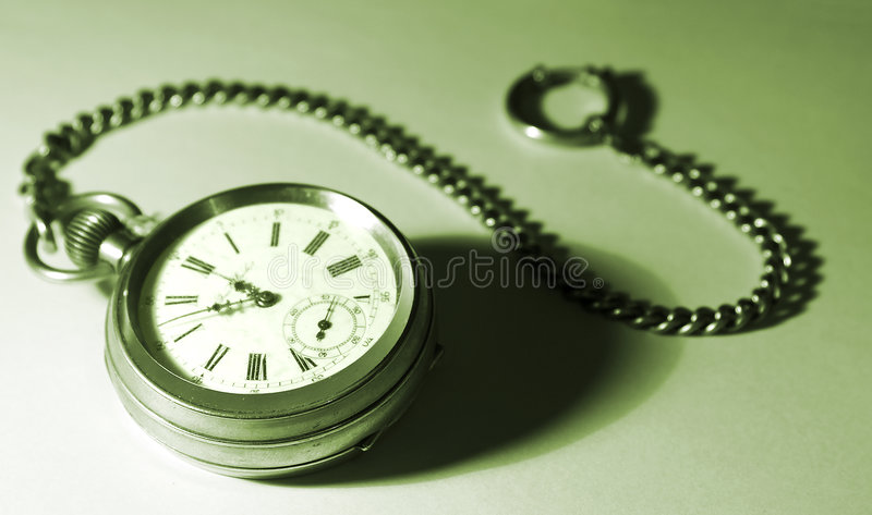 Isolated pocket watch with a chain, tinted green royalty free stock photography