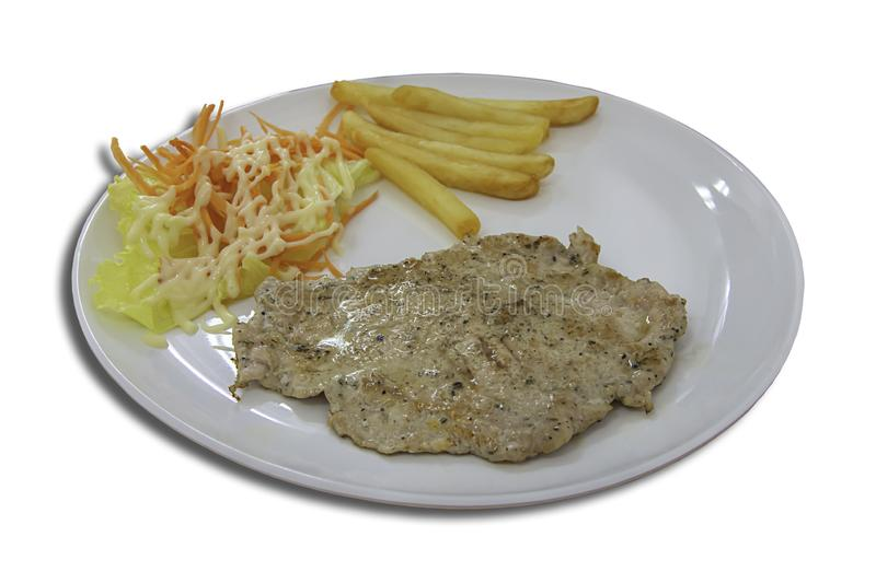 Isolated Pork steak with French fries and salad on a white background with clipping path royalty free stock images