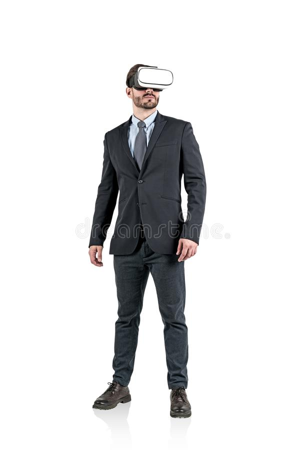 Isolated portrait of bearded young caucasian businessman wearing dark suit with gray tie and vr glasses. the concept of stock photo