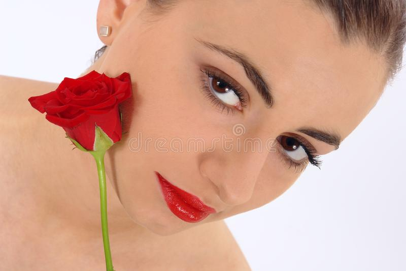 Isolated portrait of beauty with rose royalty free stock images