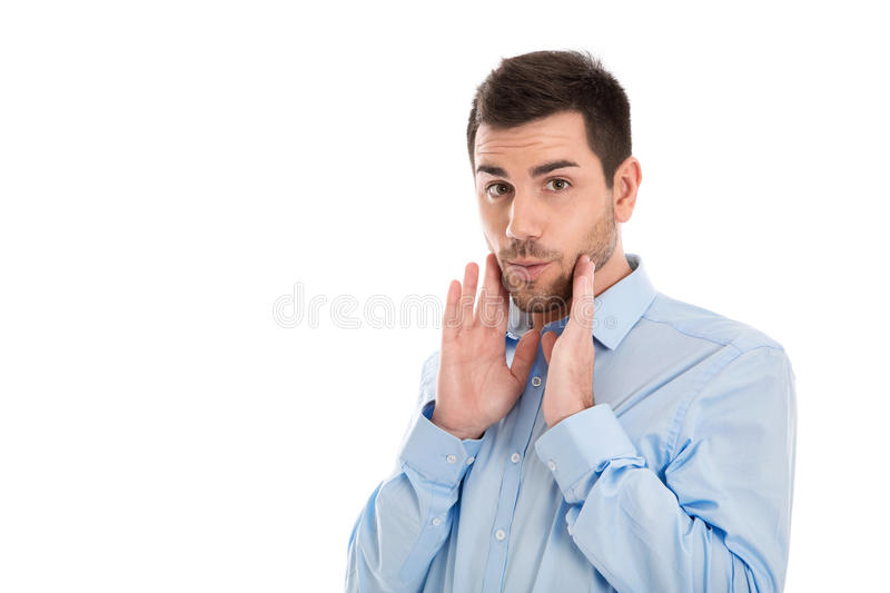 Isolated portrait of a business man wearing blue shirt with surprised and shocked expression. royalty free stock photos