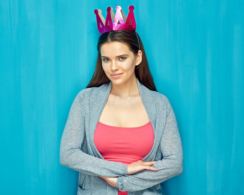 Isolated portrait of girl with paper crown blue wall back stock download isolated portrait of girl with paper crown blue wall back stock photo voltagebd Images